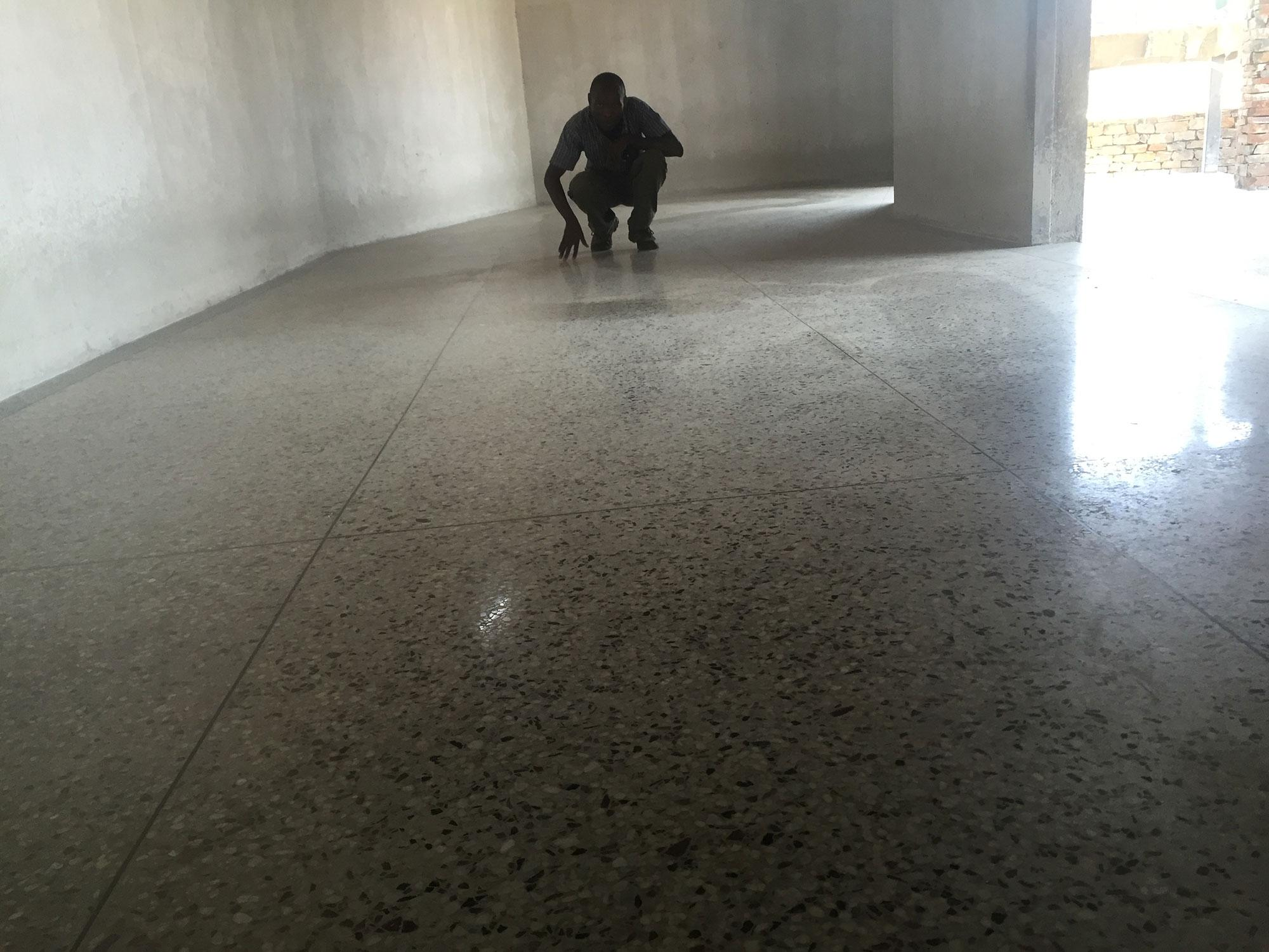 Terrazzo floors flooring solutions uganda concrete wood stone our site inspector checking finishing quality on our kibuli project dailygadgetfo Gallery